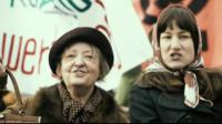 Two women on a march for women's rights in a scene from The Divine Order