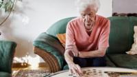 Woman doing jigsaw