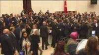 MPs fighting in Turkish parliament.
