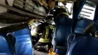 Rescuers work to free Milan passengers