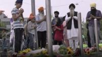 Sikhs from Germany praying