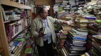 Man sorting books