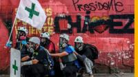 Green Cross are Venezuela's volunteers who go around Caracas helping those injured on the front line.