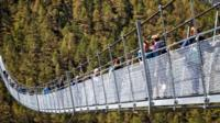 Walkers cross hanging bridge