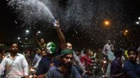 Pakistani cricket fans celebrate winning the International Cricket Championship (ICC) Champions Trophy final cricket match against India
