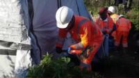 Crew member uses sledgehammer