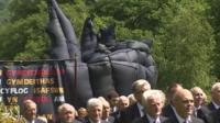 Procession transporting sculpture