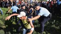 Migrants force their way through police lines at Tovarnik station