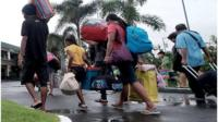 People in Philippines take shelter