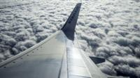 Ryanair wing above flying above clouds