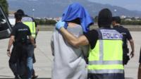 A suspected jihadist is transferred to police custody at Palma de Majorca