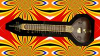 Sitar with psychedelic background