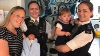 Rebecca Fox holding baby Bobby, PC Holly Foran and PC Nicola Devlin with Bobby's sister Marnie
