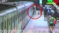 Woman stuck in train door
