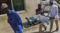 Maiduguri blast injured woman is carried on a stretcher
