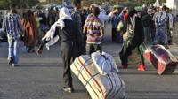 Ethiopian immigrants returning from Saudi Arabia arrive at Addis Ababas Bole International Airport on December 10, 2013.