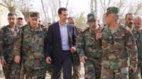 Bashar al-Assad and soldiers
