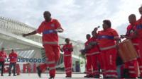 Watch the street cleaners of Rio, Brazil, celebrate their National Day by parading and dancing through the streets