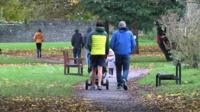 People walking through a park