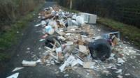Fly-tippers have left a Bedfordshire road littered with rubbish, including a toilet, a bathtub and a fridge.
