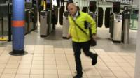 A member of the public runs for the last Tube at Euston Station