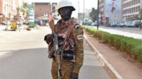 A Burkina Faso gendarme stands guard