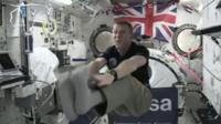 Tim Peake shows what happens when you touch your toes in space.