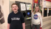 Kids with a reverse vending machine in Norway