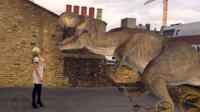 Lara Lewington with an augmented reality dinosaur