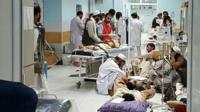 Afghan MSF medical personnel treat civilians injured following an offensive against Taliban militants