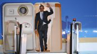 US President Barack Obama steps off Air Force One upon arrival at Stansted Airport