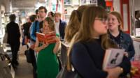 People queuing in a bookshop