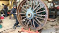 Alex Sharphouse with one of Talisman's rear wheels.