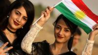 Iranian Kurdish girls hold a Kurdish flag at a gathering to urge people to vote in the upcoming independence referendum in Bahirka, in the Kurdistan Region of Iraq (21 September 2017)