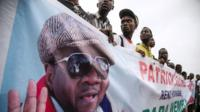 Papa Wemba fans hold sign of the late singer