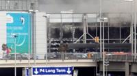 A plume of smoke rises over Brussels airport