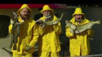 Norwegians holding cod