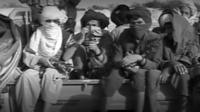 Masked men on truck
