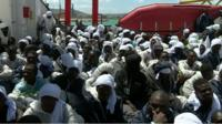migrants on the deck of rescue ship