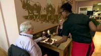 waitress serves couple
