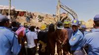 Rescuers and police at the garbage landslide site in Addis Ababa