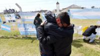 Relatives of a missing crew member hug outside the naval base in Mar del Plata (24 Nov)