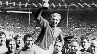 Geoff Hurst (centre) with the World Cup trophy