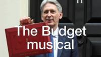 Philip Hammond holding red briefcase