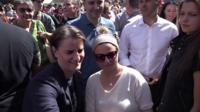 Ana Brnabic (left) at pride march in Belgrade