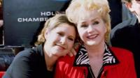 Actress Debbie Reynolds poses with her daughter actress Carrie Fisher