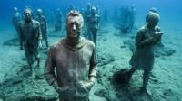 Figures from the underwater museum exhibit