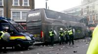 Bottles are thrown at the Manchester United team bus during clashes.