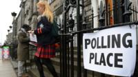 Scottish voter leaving polling station.