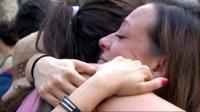 Women hug on Las Ramblas, Barcelona